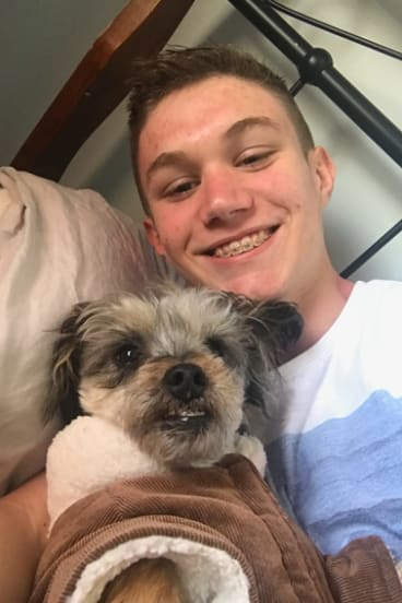 Adriaan Roodt, who died after an incident at Mount Ainslie on Thursday, and one of his dogs, Muffin.