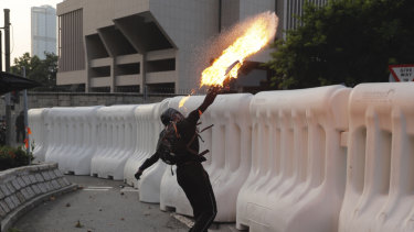 You won't see this on TikTok: An anti-government protester throws a Molotov cocktail during a protest in Hong Kong.