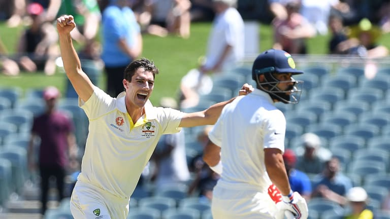 Huge wicket: Pat Cummins celebrates the dismissal of Virat Kohli as Australia get out of the blocks fast in the first Test.