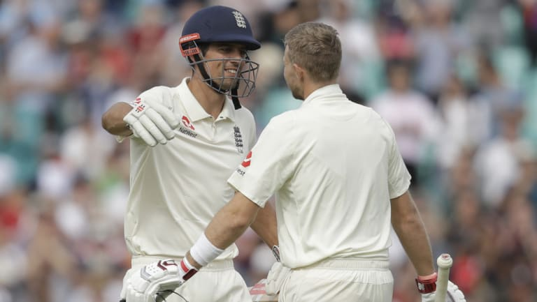 Congrats: Joe Root (right) celebrates his own century with Cook.