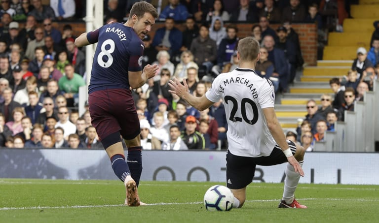 Arsenal's Aaron Ramsey scores his side's third goal against Fulham at Craven Cottage on Sunday.