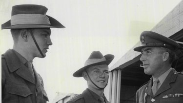 David Roubin (left) and another national serviceman are met by a colonel at the start of a course at north-west Sydney's Scheyville Officer Training Unit.