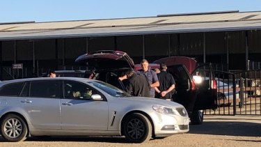 Police rad the stables of horse trainer Darren Weir on Wednesday.