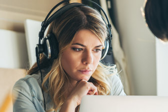 Wearing headphones in the office is a rising trend.