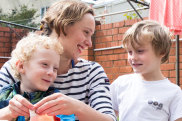 Pip Hall, who is running a children's activity program for the MCA, with her  twin boys, Vincent and Nolan, 6.