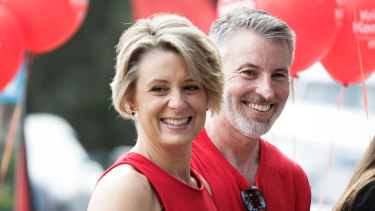 Kristina Keneally with her husband Ben, who is employed by Boston Consulting Group, which is advising the department on process.