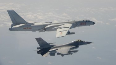 A Taiwan Air Force F-16 fighter jet flies alongside a Chinese H-6K bomber during an earlier incursion.