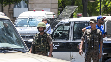 Tunisian soldiers stand guard after an explosion in Tunis.