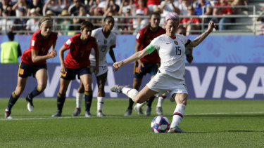 Spot on: Rapinoe scores her side's second goal from a penalty.