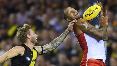 Nathan Broad attempts to spoil Sydney's Lance Franklin.