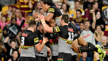 The Panthers celebrate another try.