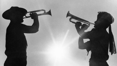 Two boy scout members play the bugle at the 12th World Boy Scout Jamboree at Farragut State Park in Idaho in 1967.