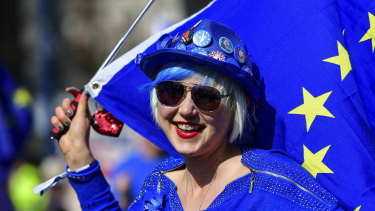 Madeleina Kay, Young European of the Year 2018 dressed in blue holds an EU flag and entertains the public while singing about Brexit outside the Houses of Parliament in Westminster, London, ahead of the latest round of debates.
