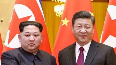 North Korean leader Kim Jong-un, left, and Chinese President Xi Jinping poses for a photo in Beijing in 2018.