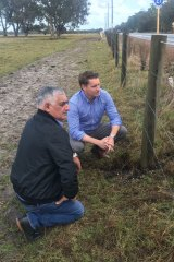 Vince Borello and Canning MP Andrew Hastie inspect the damage.