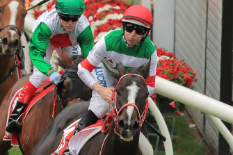 Damien Lane has backed up his Cox Plate win on Lys Gracieux to win the group 1 Arima Kinen in Japan.