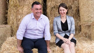 Premier Gladys Berejiklian and Deputy Premier John Barilaro, on Boyd Baling farm in Lismore.