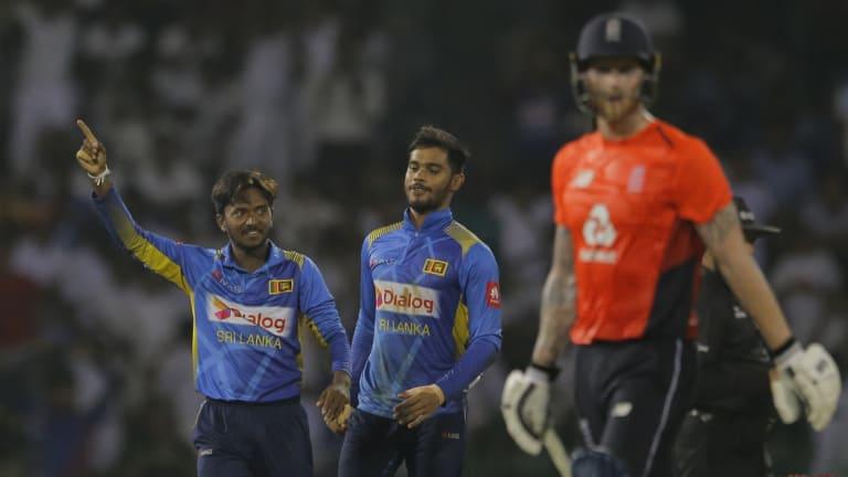Sri Lanka's Akila Dananjaya celebrates the dismissal of England's Ben Stokes.