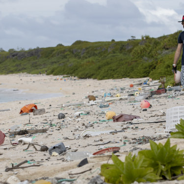 Recycling expert James Beard picks up rubbish along the beach.