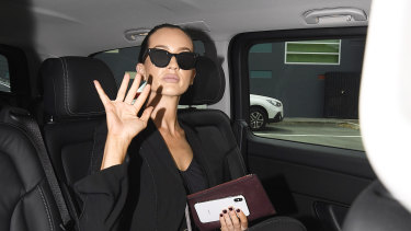Married At First Sight star Ines Basic waves as she departs in a limousine following her sentencing for drink driving at the Cleveland Magistrates Court in Brisbane on Tuesday.