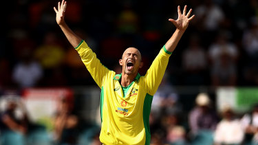 Ashton Agar of Australia celebrates after taking the wicket of KL Rahul of India during game three of the One Day International series between Australia and India at Manuka Oval.