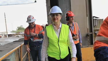 Premier Annastacia Palaszczuk dons the first hardhat of the campaign on  her visit to the Mount Isa Copper Smelter