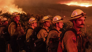 Firefighters monitor the Sugar Fire, part of the Beckwourth Complex Fire, in Doyle, California last week.