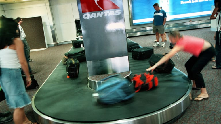 The woman was arrested over the theft of 18 items of luggage from carousels at Melbourne airport.