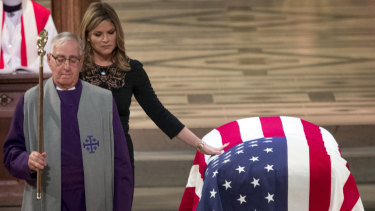 Jenna Bush Hager, the daughter of former president George W. Bush, touches the casket of her grandfather, former president George H.W. Bush, after speaking at his state funeral.