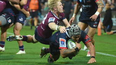 Tetera Faulkner scores the Rebels third try - and his third Super Rugby career try - on Friday night against Queensland.