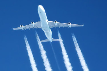 contrails streaming from a jumbo jet