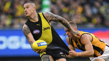 Thirst for ball: Dustin Martin (left) evades James Worpel.