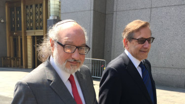 Convicted spy Jonathan Pollard, left, with his lawyer, Eliot Lauer, leaves federal court in New York following a hearing in 2016.