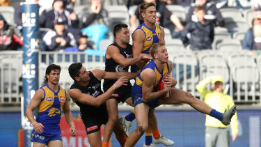 First served: Oscar Allen marks ahead of the pack during West Coast's win over Carlton at Optus Stadium in Perth.