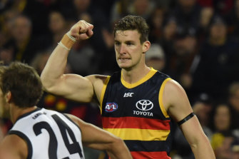 Josh Jenkins celebrates a goal with the Crows last season.