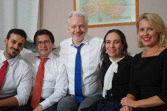 Julian Assange, centre, with Stella Morris, right, and his Ecuadorian counsel Carlos Poveda, left, in an undated picture supplied by WikiLeaks.