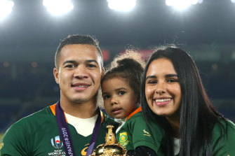 Cheslin Kolbe shares the trophy win his daughter, Kylah, and wife, Layla.
