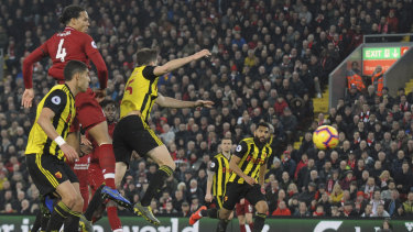 Liverpool's Virgil van Dijk scores his side's fifth goal against Watford.
