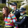 Hundreds of police swarm St Kilda foreshore to contain protesters