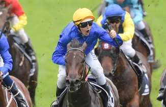 Beating the odds: Damian Lane rides Kiamichi to victory in the Golden Slipper at Rosehill.