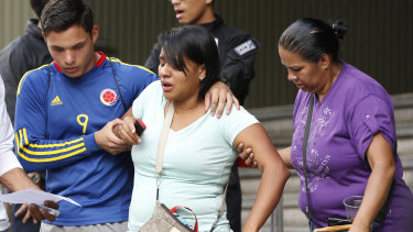 Barbara Barca, a survivor of the stampede at a crowded nightclub, is helped by relatives as they leave police headquarters in Caracas, on  Saturday.