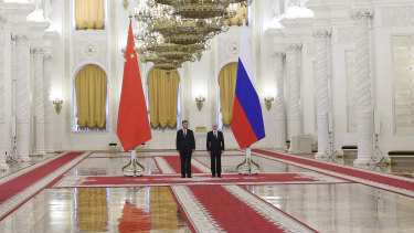 Grand vision: Russian President Vladimir Putin with his Chinese counterpart Xi Jinping in the Kremlin on Wednesday.  Xi Jinping is also expected to attend the St Petersburg conference.