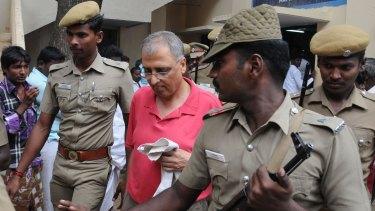 Art dealer Subhash Kapoor is brought into court in India in 2012.