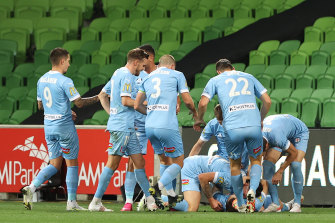 Melbourne City players celebrate after Scott Galloway's goal to seal their win over Brisbane.
