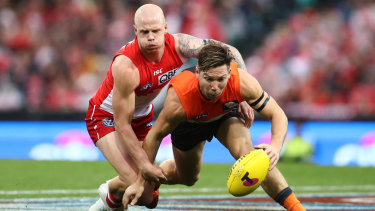 Toby Greene contests the ball with Zak Jones of the Swans.