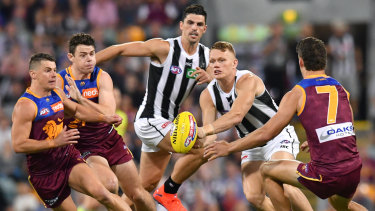 Handy: Adam Treloar (second from right) dominated in the midfield for the Magpies.