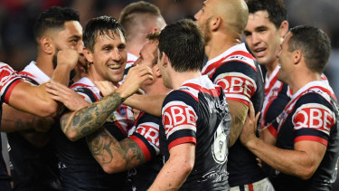 No hard feelings: Mitchell Pearce is mobbed by Roosters before he made his exit from the Bondi club.