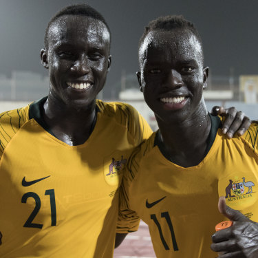 Thomas Deng (left), 21, debuted for the Socceroos alongside childhood friend Awer Mabil last year.