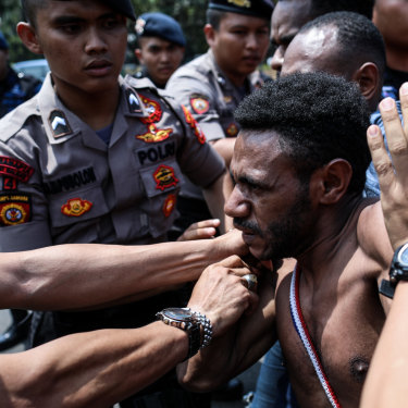 Police block Papuan protesters in Jakarta on August 22.