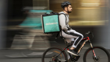 A food delivery rider in Chinatown, Sydney.